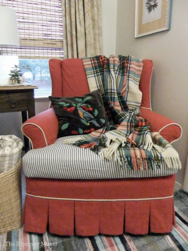 Red canvas slipcover with ticking detail.