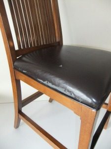 Makeover for torn leather dining room chairs.